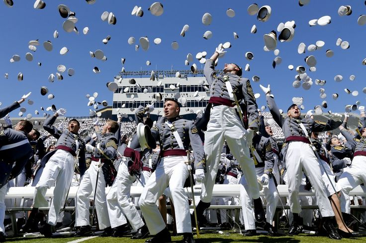 Graduates from the U.S. Military Academy toss their hats into the air after a graduation and commissioning ceremony on Saturday in West Point, N.Y.