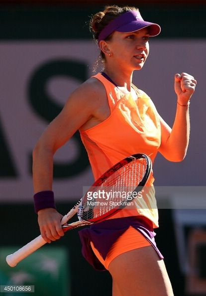Simona Halep of Romania celebrates a point during her women's singles match against Andrea Petkovic of Germany on day twelve of the French Open at Roland Garros on June 5, 2014 in Paris, France.