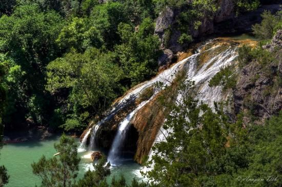 Turner Falls Park. Hiking trails that lead into Arbuckle Mountains.  OK's largest waterfall--bring swimsuit--crowded in summer so to avoid crowds, drive to Bridal Veils Falls. Honey Creek tumbles 77 ft down, creating natural swimming pools.
