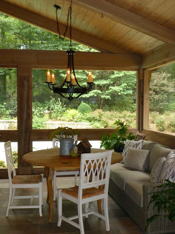 Craftsman Porch with Chandelier, exterior tile floors, White Kousa Dogwood, Woodhaven Plank Wood Ceiling, Raised beds