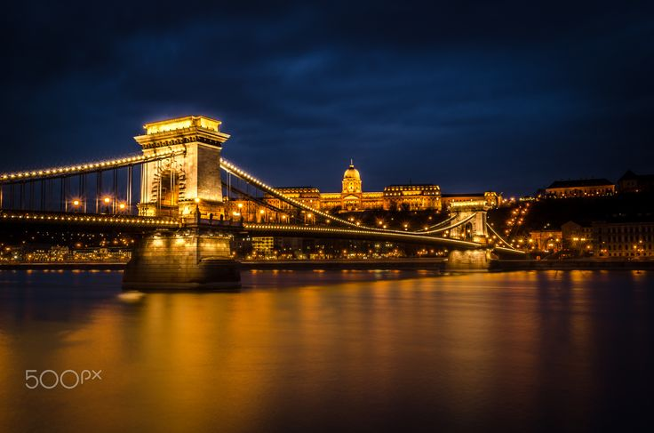 """Nightfall - The Chain Bridge, Budapest with Buda castle in the background. A beautiful city that lights up the Danube. Please visit my <a href=""""https://www.facebook.com/kathrynconwayphotography"""">Facebook Page</a>, <a href=""""https://instagram.com/conwaykathryn/"""">Instagram</a> or <a href=""""https://twitter.com/kcgrasshopper/"""">Twitter</a>"""