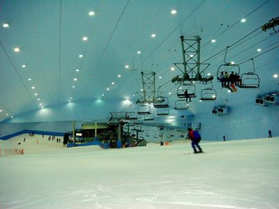 This is an indoor ski mountain in Dubai. Outside it is at least 90 degrees F but inside it is always at least 30 degrees F. This is one of 5 ski mountains worldwide with others in N. Zealand, Germany, England and Holland. The biggest is in Holland and covers 100,000 square feet and has five trails, one of them a 1/4 mile in length. The interior is made to look like the alps, including the buildings and food. Snowboarding and skiing is allowed. Olypmpic hopefuls practice here.
