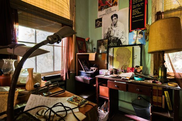 It's clear the house owner was a fan of Elvis with pictures and posters surrounding a cluttered desk with two art-deco lamps