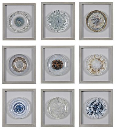The everyday is elevated in this truly unique three dimensional piece. Nine distinct, beautifully hand-painted plates are individually set in brushed silver frames, creating a playful grouping.