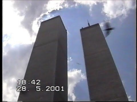 home movie in May 2001 of the WTC. Nothing scary for kids. This shows what it was like to visit the WTC before 9/11 happened. (That is a bird in the picture not a plane)