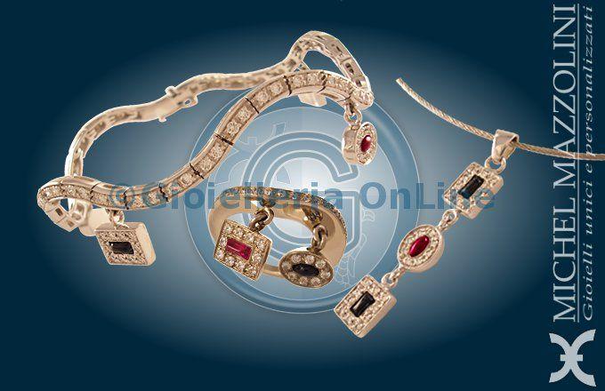 collezione Waving Stars. Anello, bracciale e orecchini in oro bianco con diamanti e rubini taglio cabochon. Inserti mobili.