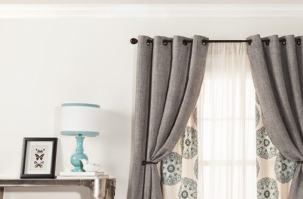 """layered curtains - outer curtain to help """"black out"""" the room but also keep it bright and a patterned curtain for style"""