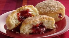Sweet rolls using Grands! biscuits. Recipe is great as is, but I'm thinking maybe a little sweetened cream cheese piped in along with the jam!