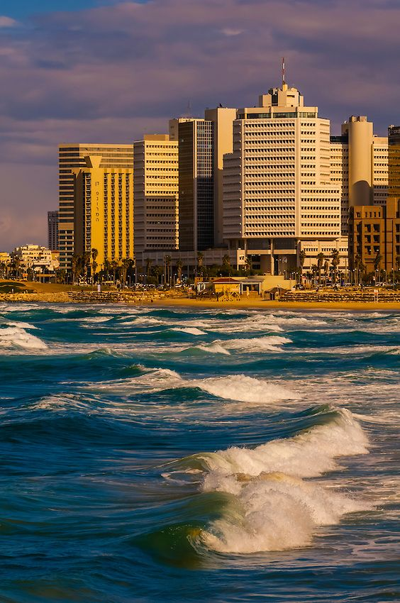 Waves from the Mediterranean Sea with the beach front of Tel Aviv, Israel. AND especially here!