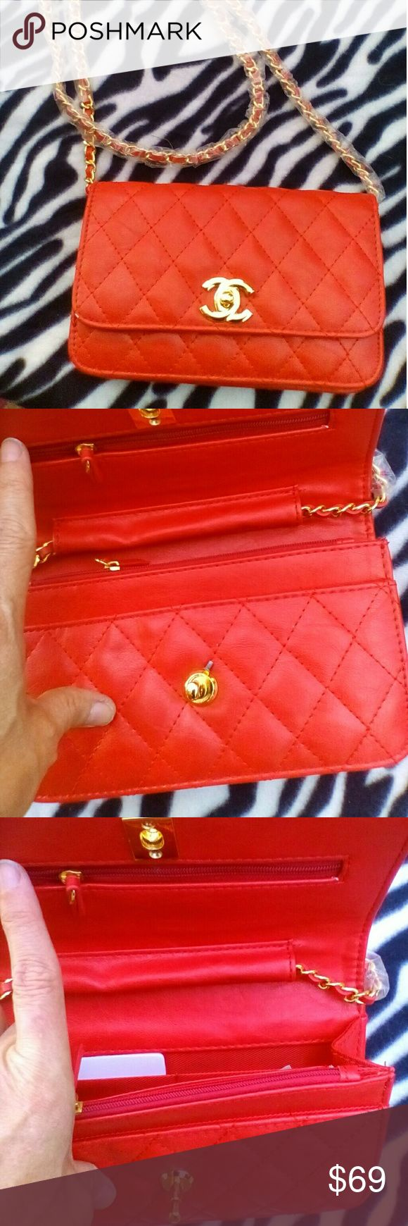 NWOT Red C.hanel Mini Quilted Shoulder Bag NWOT CUTE Chanel Mini Quilted Shoulder Bag. Chain Shoulder Strap still has plastic on it. Beautifully designer inspired. Price reflects auth.  Shop my closet for more deals. Bundle and save. Happy Poshing! Bags Shoulder Bags