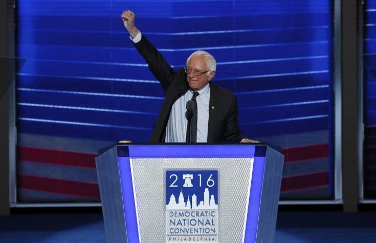 Sen. Bernie Sanders thrusts his fist in the air as he arrives to speak during the first session at the Democratic National Convention in Philadelphia.  PHILADELPHIA, Pa. — The…
