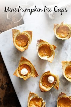 These mini pumpkin pie cups that use wonton wrappers instead of traditional pastry crust are perfectly portioned and so easy to make. They're excellent for a holiday party or a creative Thanksgiving dessert! // thanksgiving recipes // healthy recipes // cheats and treats // fall recipes // pumpkin // vegetarian // baking