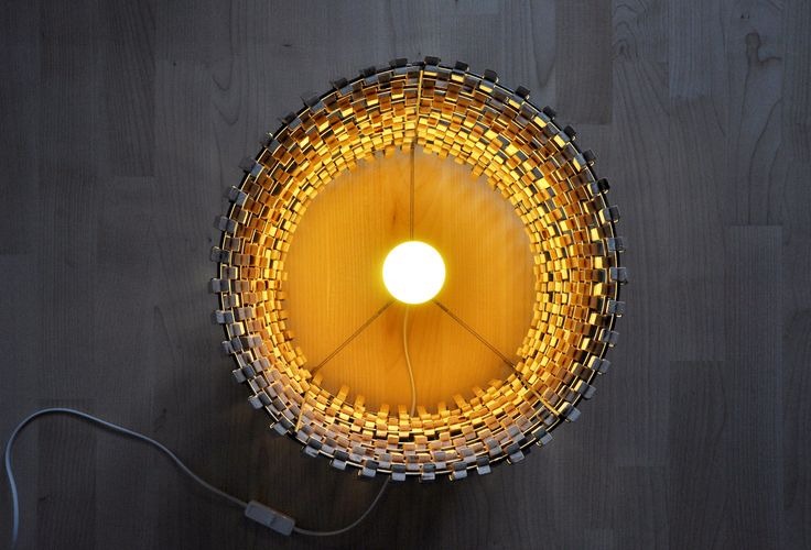 Floor lamp made with wooden clips by Crea-Re Studio. Makes beautiful shadows on the floor. Available on Etsy