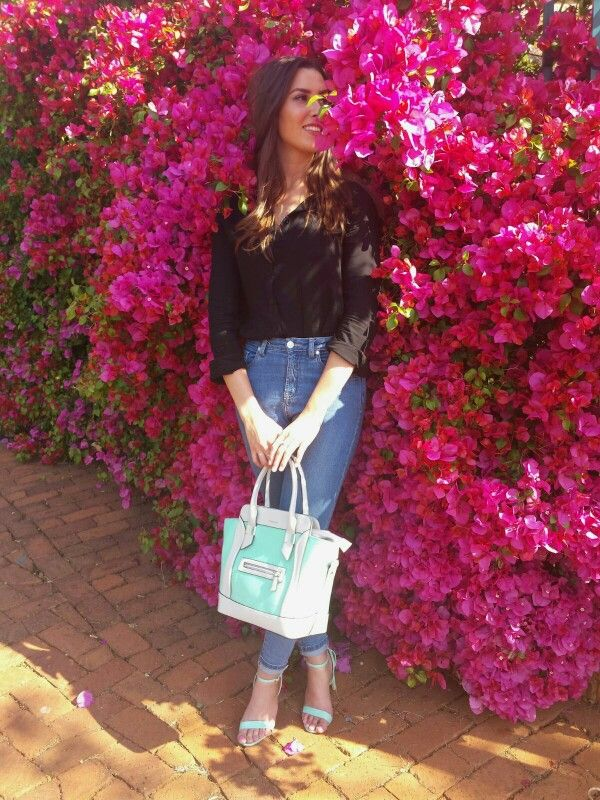Basic black button blouse with high waisted blue jeans. Turquoise handbag and heels. Call it spring : www.feliciadebeer.co.za