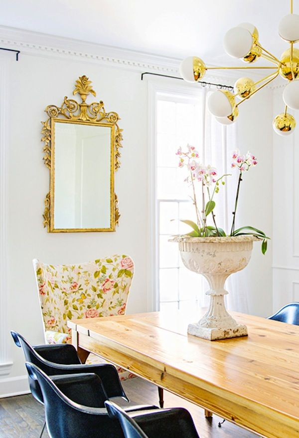 Glam Decor In A Dining Room Featuring An Ornate Gold Frame Mirror Modern