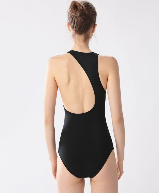 Asymmetric swimsuit, 1299UAH - Black asymmetric swimsuit. Larger opening on the left side - Find more Spring Summer 2017 trends in women fashion at Oysho.