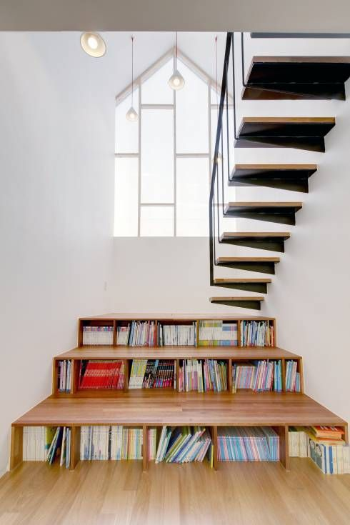 A creative and stylish way for under stairs storage by MLNP Architects from Korea! #storageideas #stairs #understairstorage #homify