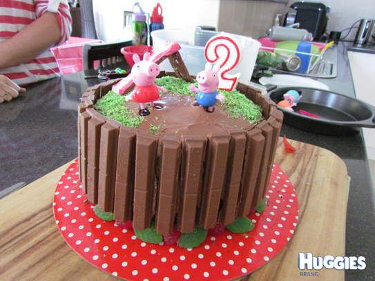Red Velvet Chocolate Cake with Chocolate Cream Cheese surrounded in kit kats topped off with some green coconut for grass, a slippery dip made out of curly wurly and royal icing, dont forget to leave a big muddy puddle for  Peppa and George to jump in!