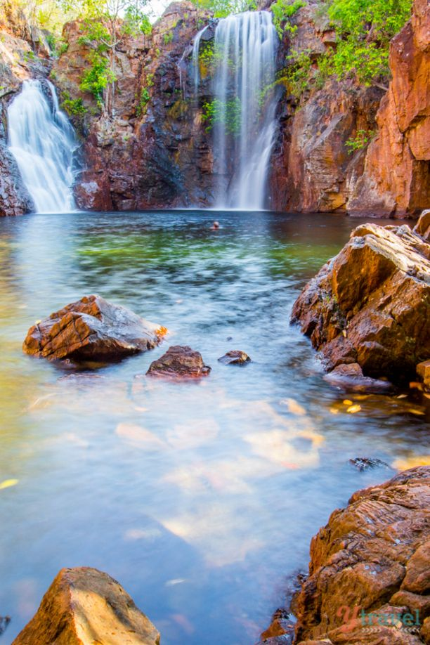 Florence Falls, Litchfield Park, Australia — by Caz and Craig @yTravelBlog. Florence Falls is a double-plunge waterfall leading to a popular swimming hole. There's a steep staircase down to the...