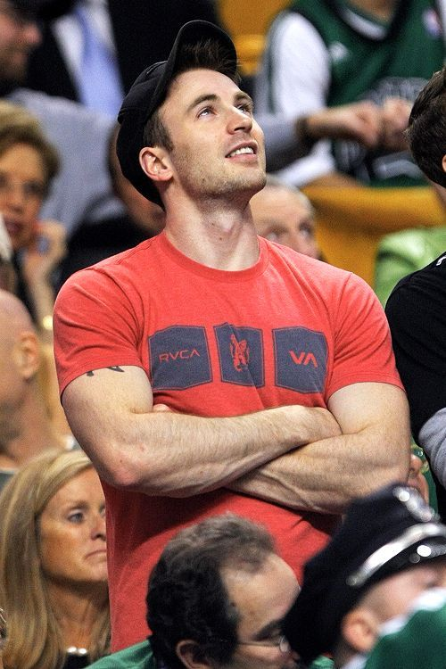 Chris Evans favorite pink shirt, wearing since 2010. Looks orange in that light, but it is definitely pink.