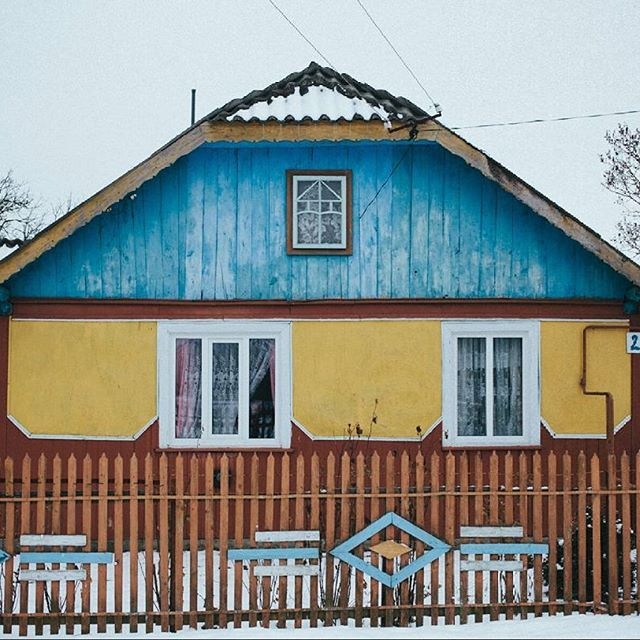 @chrisnunnphoto here. A house painted in the colours of the Ukrainian flag in Tuzhilov, the village where my grandmother was born.  February 2013 Ivano-Frankivsk region
