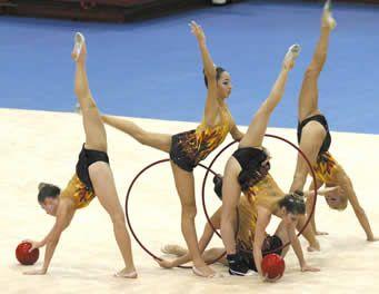 A ginástica rítmica, também conhecida como GRD ou ginástica rítmica desportiva (nomeclatura antiga), é uma ramificação da ginástica que possui infinitas possibilidades de movimentos corporais combinados aos elementos de balé e dança teatral, realizados fluentemente em harmonia com a música e coordenados com o manejo dos aparelhos próprios desta modalidade olímpica, que são a corda, o arco, a bola, as maças e a fita.