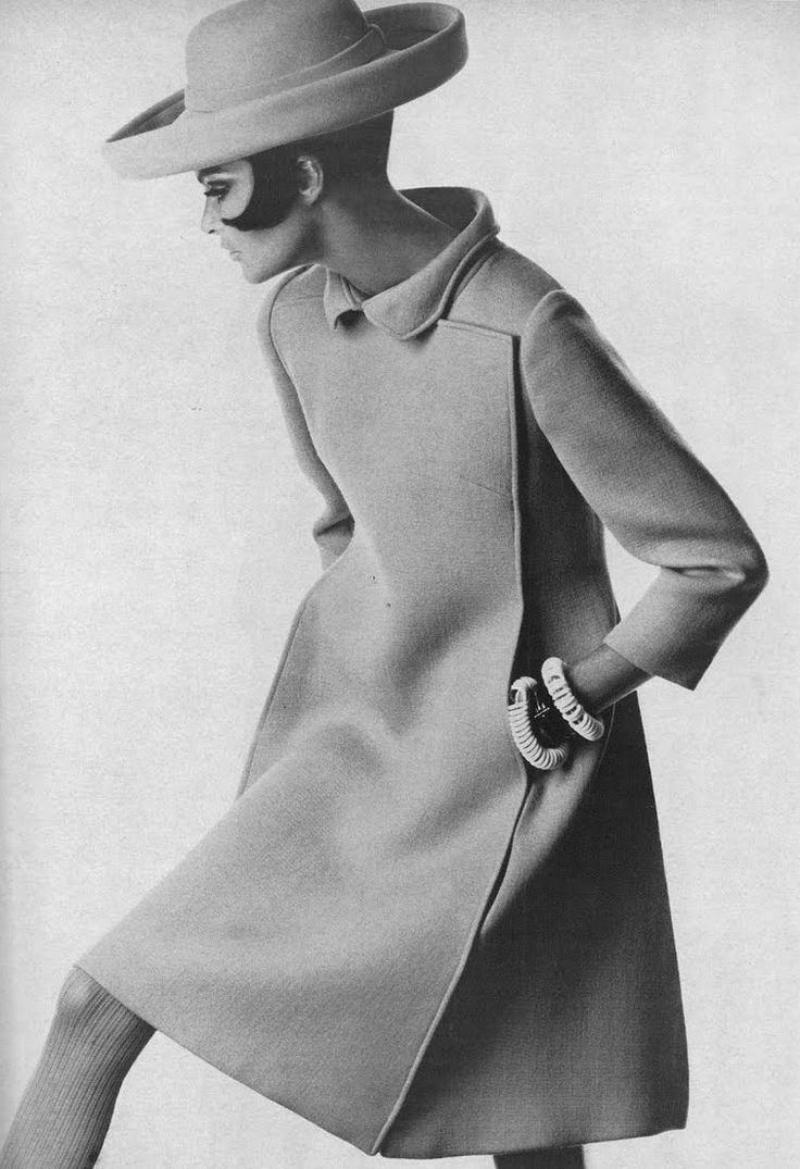 Editha Dussler is wearing a sharp green coat with blind closing and giant square-seamed pleats in the back by Stanley Nelson, wide roller by Emme, photo by Penn for Vogue, 1967