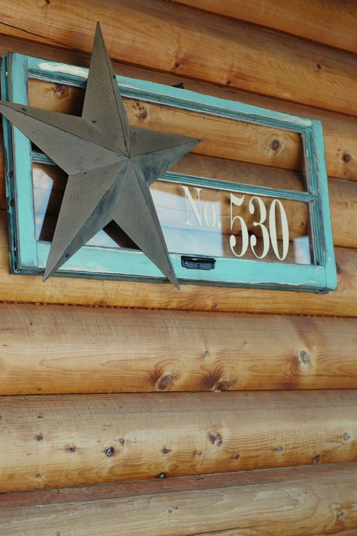 Painted turquoise old window frame with metal barn star for House number frames