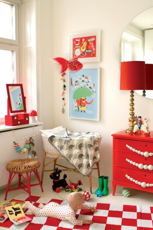love that there's no theming - just the red.  But seriously, that baby does NOT fit in that bassinet ... this room needs a crib