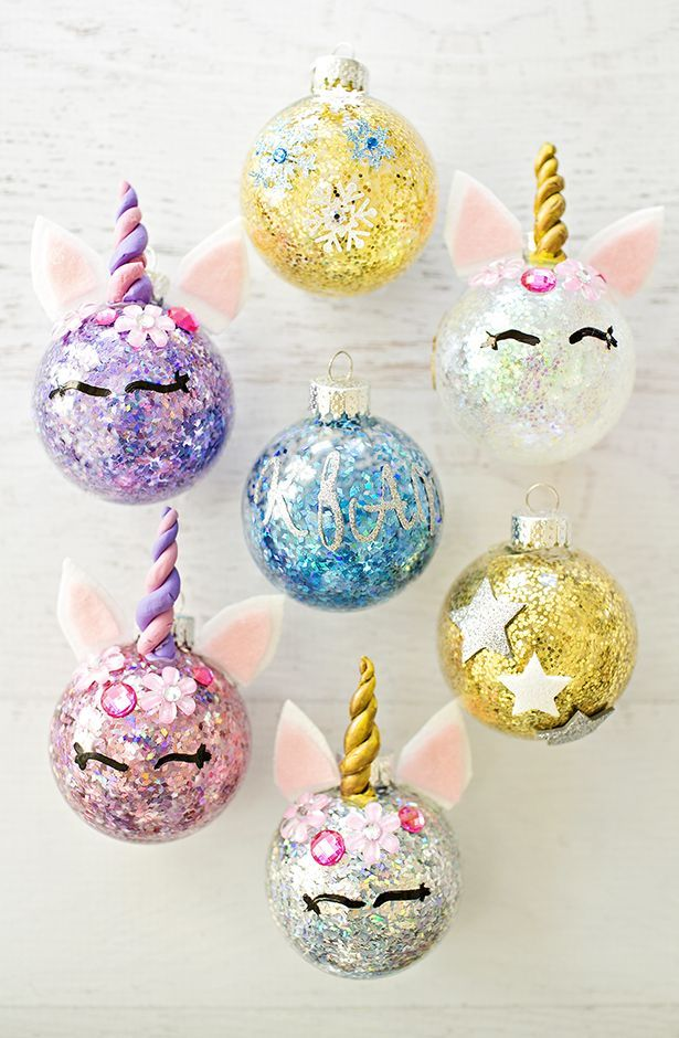 DIY Glitter Unicorn Ornaments. Find out how to easily glitter ornaments and  turn them into unicorns. #unicorncrafts #diyornaments #kidscrafts - DIY GLITTER UNICORN ORNAMENTS DIY Holiday Decor Pinterest Diy