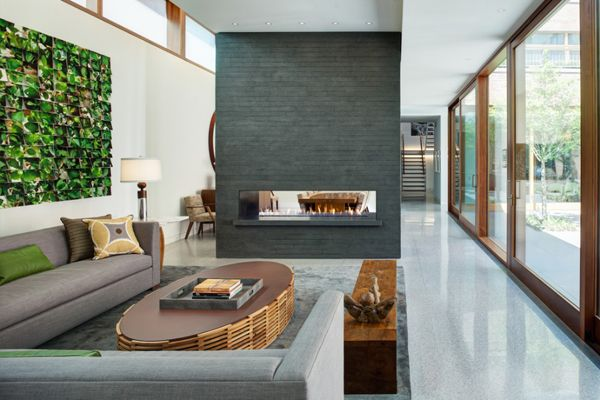 Fireplace doubling as divider - light and spacious yet luxurious all combined