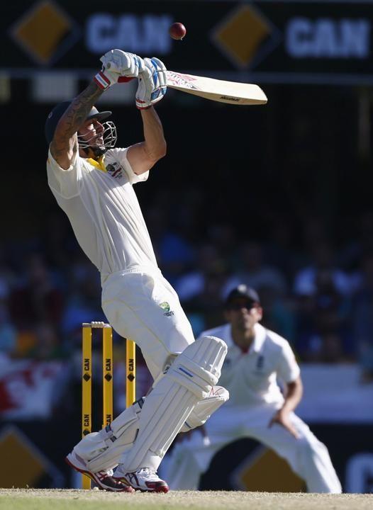 Australia's Mitchell Johnson plays a shot during the first day's play of the first Ashes cricket test match against England in Brisbane November 21, 2013.