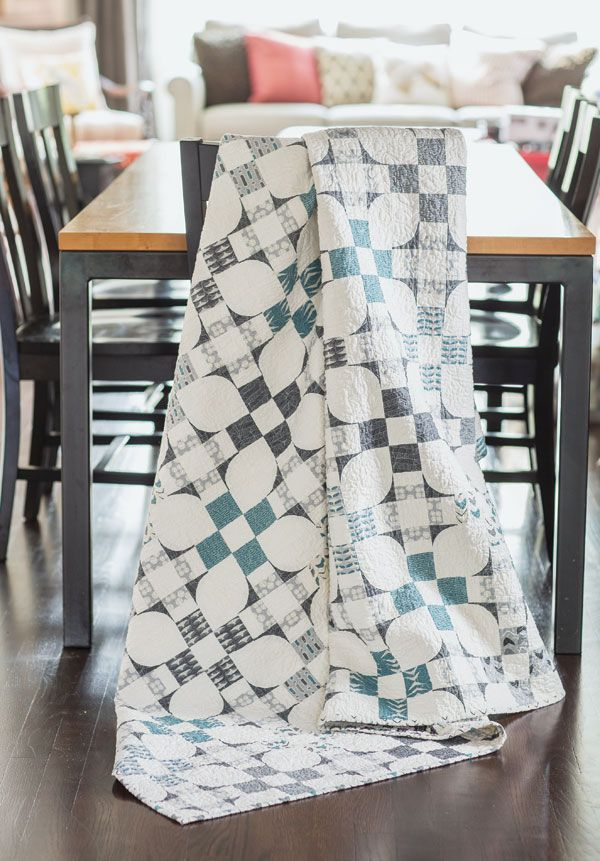 Do you see flowers, Nine Patches, or Churn Dash quilt blocks? Using only white and shades of gray, Amy Ellis has created a quilt with strong visual interest.