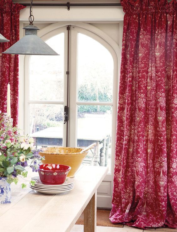 Pretty red curtains in kitchen by Kate Forman