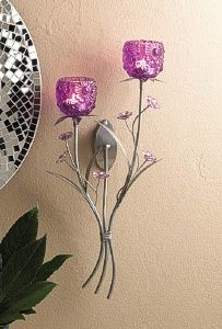 Light your wall with brilliant fuchsia shine from this stunning sconce. Silvery stems hold delicate flowers and two flowery candle cups that are ready for the candles of your choice. http://www.wholesalemart.com/Wholesale-Candle-Holders-s/85.htm