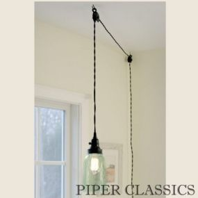 "Mason Jar Pendant Light with black lid includes a Quart mason jar with no bottom.  The open bottom and ventilated top provides plenty of light while keeping everything cool.  4"" diameter and 10"" tall. Shown with our 40 watt vintage bulb."