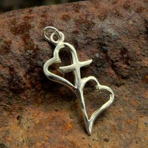 """Hearts connected by the cross symbolize the bond we have through Christ to others. A lovely gift for a friend, sister in Christ or for those serving in missions.  Pendant measures 1 3/8"""" x 5/8"""".  Alternate photo shows difference in size between the large and small pendants.  All sterling."""
