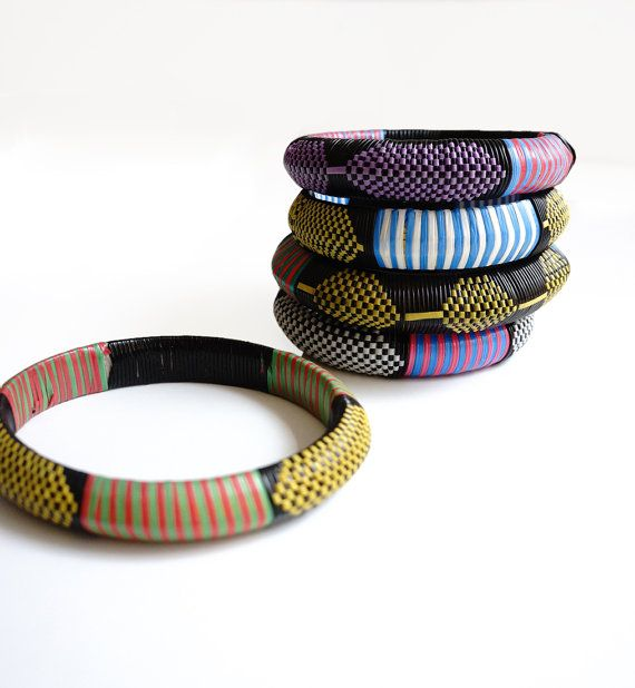 stacking handwoven plastic Tuareg bangles from Burkina by OBJEKTUM