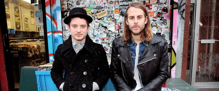 PHOTO: Elijah Wood, left, and Zach Cowie, right, are pictured in front of A1 Records in New York City on Jan. 19, 2015.