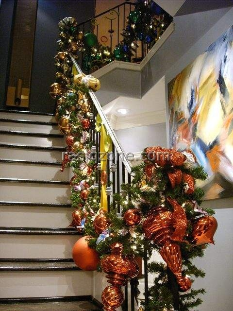 17 best images about christmas stairs on pinterest for Stair railing decorated for christmas