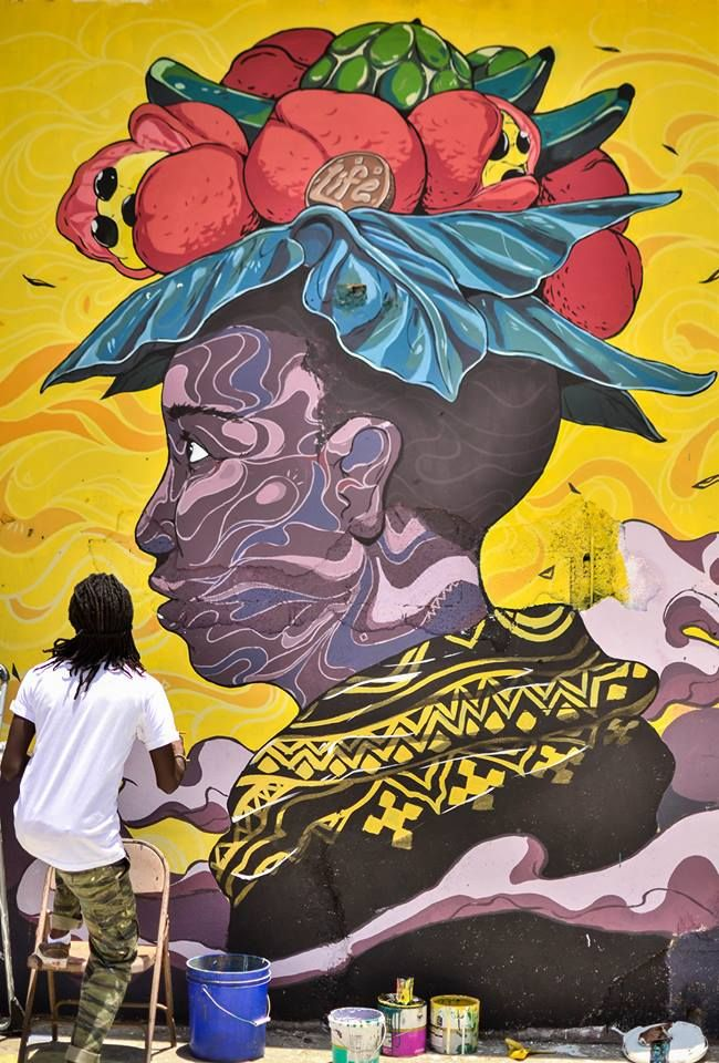 Artist - Taj Francis (photo by Matthew Henry) Paint Jamaica mural (2014) in Parade Gardens Kingston.