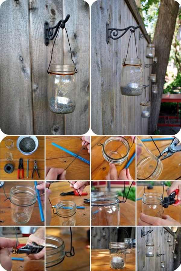 MASON JARS :: DIY Mason Jar Lantern Tutorial :: Fill with sand & a tea light, wrap w/ wire & hang from plant hangers. Love the look of many of them on the wooden fence...probably beautiful at night.