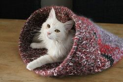 Crochet Cat Cave. Uses a flexible plastic circle for opening and sever strands of yarn with size 12 crochet hook.