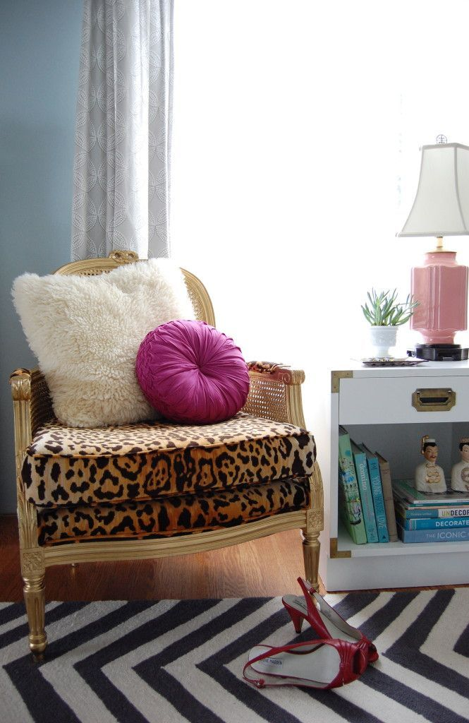 gold bergere cane chair with jamil natural leopard print fabric   white campaign side table with vintage accents :: anthologyhouse