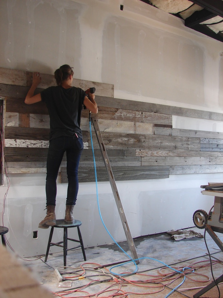 Ariele Alasko constructing a wall for a restaurant. She traveled across America to find the wood used for the walls and tables. #recycling. #repurposing. brooklyn to west: A B O U T A R I E L E