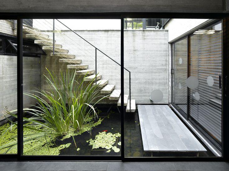 casa del arquitecto, santiago de chile - walkway appears to float over water courtyard