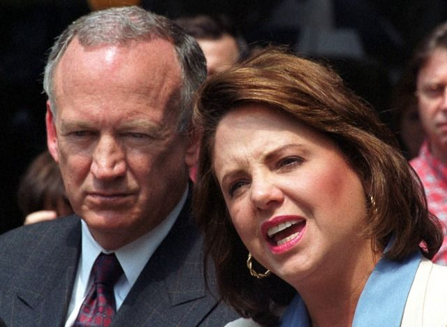 Patsy Ramsey speaks as her husband John Ramsey listens during a news conference in Atlanta on Aug. 29, 2000. In a new interview with People magazine, John