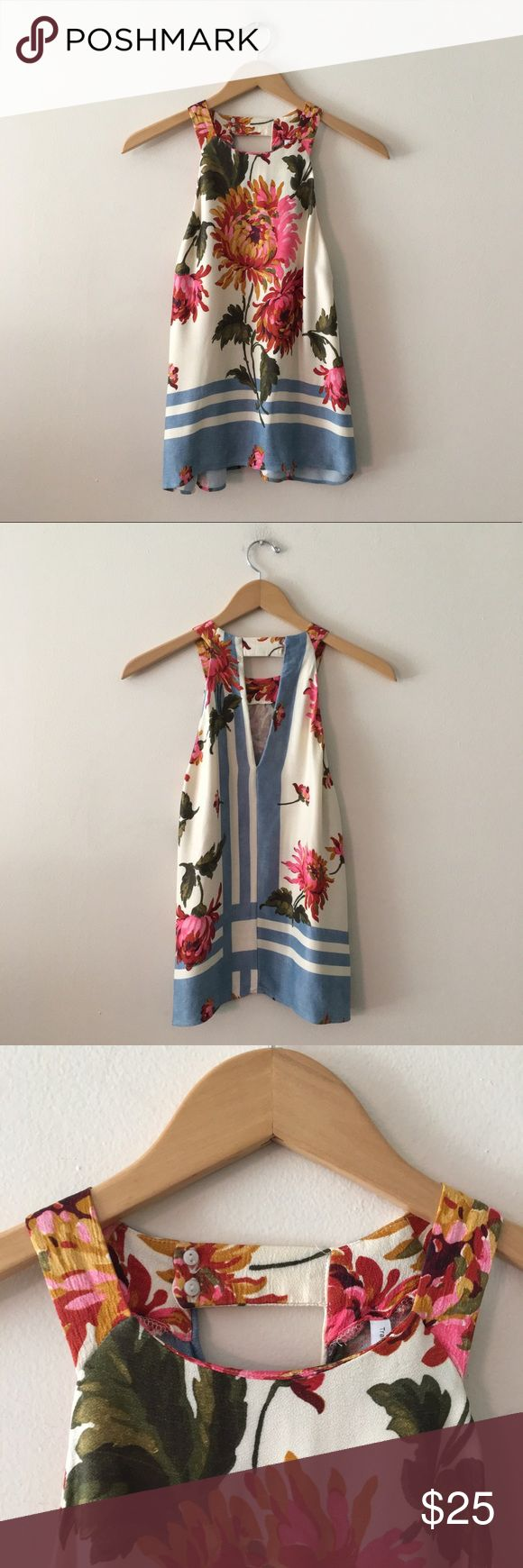"""Zara Floral Print Halter Top Blouse Halter neck sleeveless top from Zara. Featuring a multicolored floral and geometric print. Shirt closes at the back of the neck with two inward facing buttons. Back also features a keyhole design. Loose fit. Length: 24"""" Armpit to Armpit: 19.5"""" Zara Tops"""