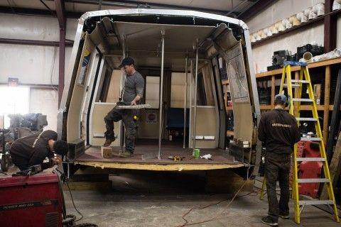 A sculptor transforms Metro's defunct rail cars into kiosks for retail use.