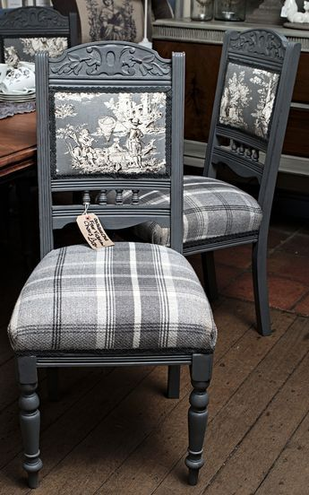 A set of four Victorian chairs painted in Autentico Pigeon Grey and reupholstered in Balmoral Tartan check fabric and toile. A bit Queen Victoria meets Louis XIV if that were historically possible!